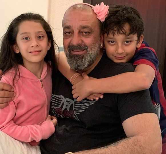 Iqra Dutt with her father and brother