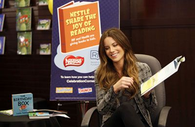 Kate Beckinsale Reading Books to Children at Nestlé Share the Joy of Reading Program
