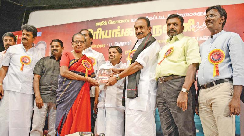 Padmavathi Ammal, mother of Nalini, receiving the first copy of her daughter's book from MDMK general secretary Vaiko