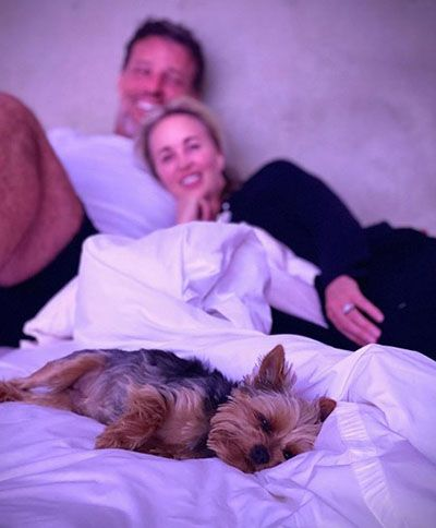 Sage Robbins and her husband with their dog