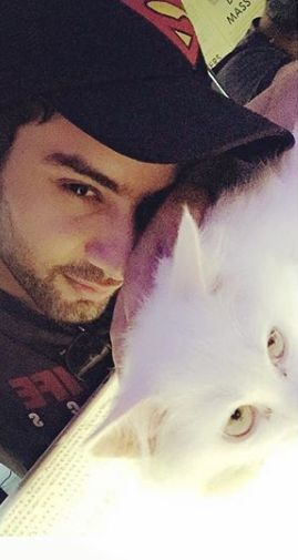 Sahil Uppal with a Persian cat