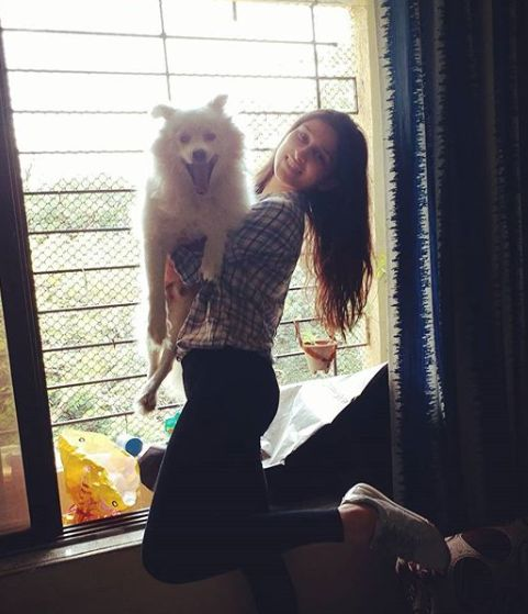 Sheen Dass with her pet dog