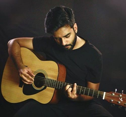 Yashraj Mukhate Playing the Guitar