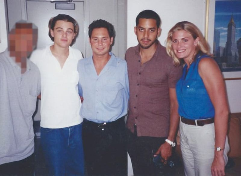 Amy Dorris posing with David Blaine (second right) and Leonardo DiCaprio (second left) in the box at the US Open in 1997