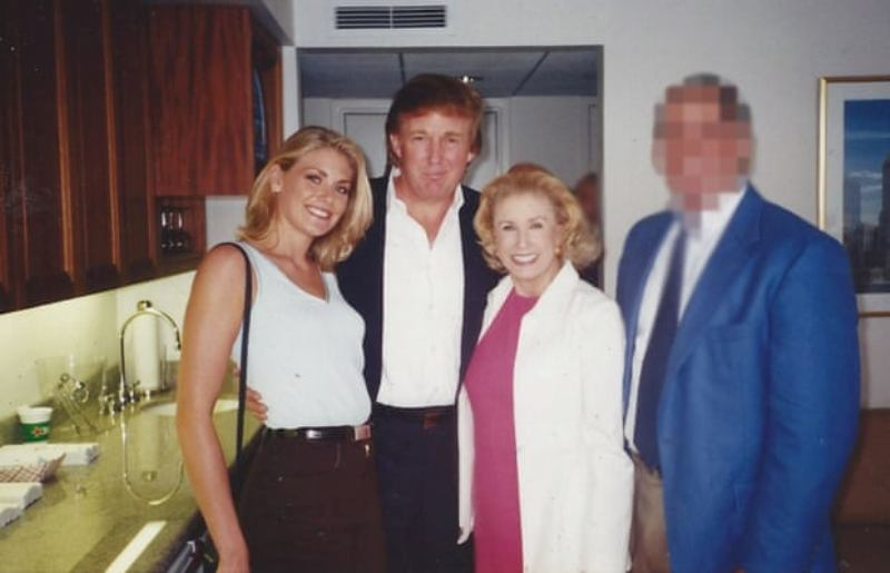 Amy Dorris posing with Donald Trump at the US Open in 1997