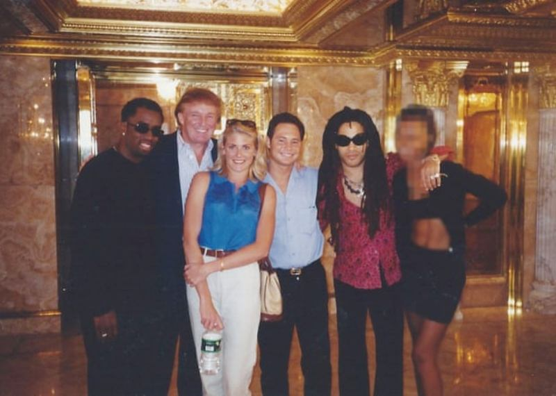 Amy Dorris posing with Puff Daddy (left) and Lenny Kravitz (second right) at Trump Tower