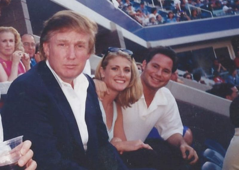 Amy Dorris sitting between Donald Trump and her boyfriend watching a match at the US Open 1997