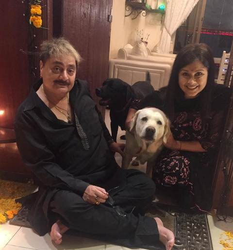 Dolly Minhas with her husband and pet dogs