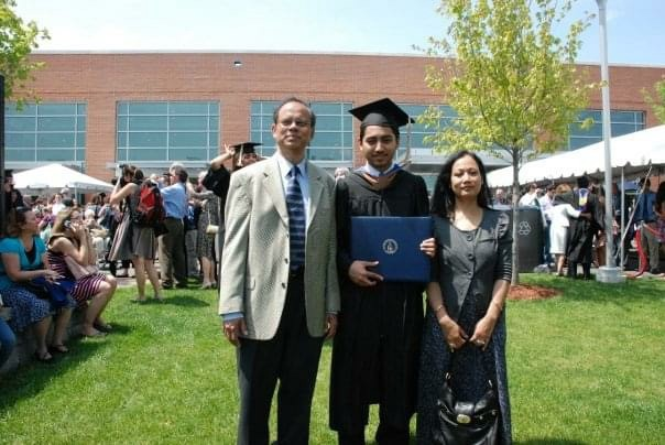 Fahim Saleh with his parents on his graduation day