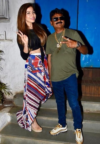 Just Sul and Kanika Kapoor together outside a restaurant
