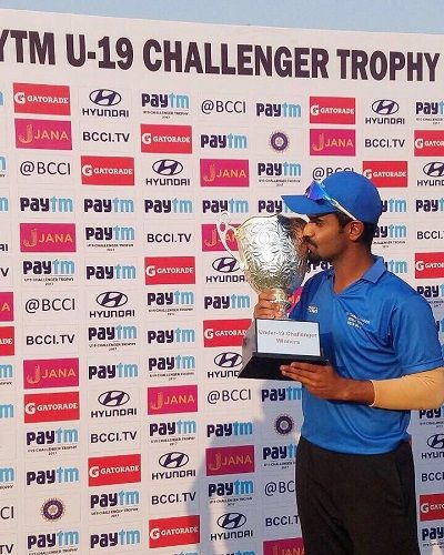 Om Bhosale Holding His Trophy