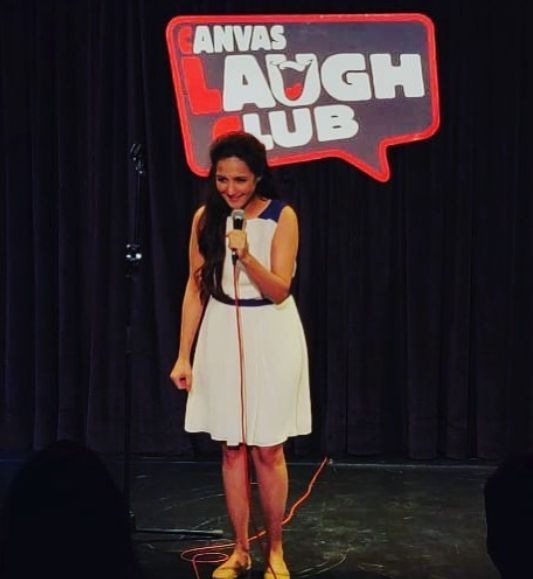 Pooja Ruparel doing stand-up comedy