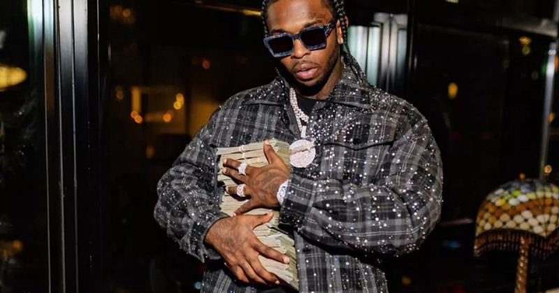 Pop Smoke with cash in hands in a social media photo