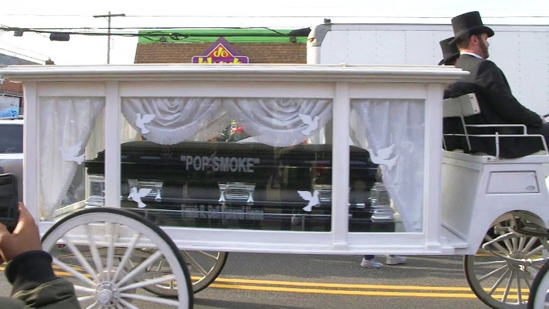 Pop Smoke's casket in a carriage going through Brooklyn