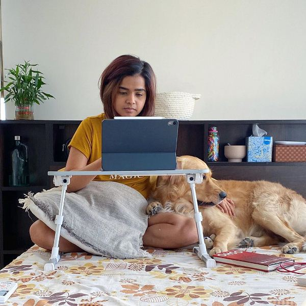 Suhani Shah working with her dog, Steve