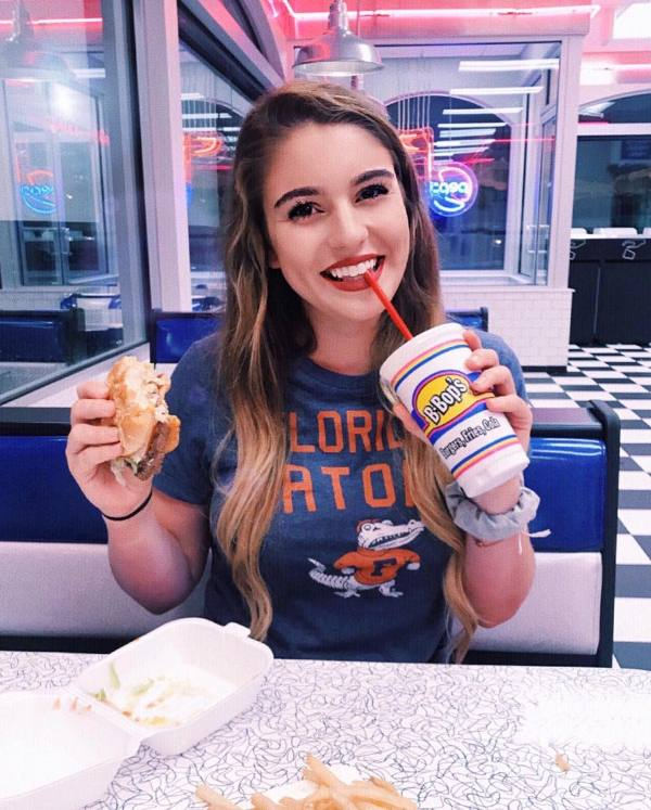 Taya Miller at a diner with a friend