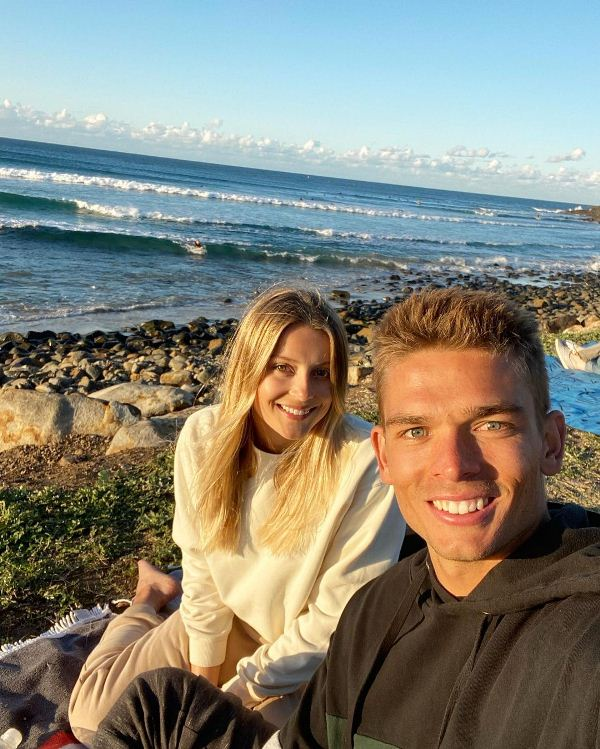 Chris Green with his girlfriend Bella Wagschall at the beach