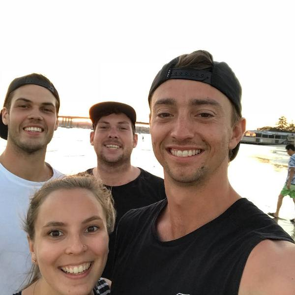 Daniel Sams with his wife and friends at the beach