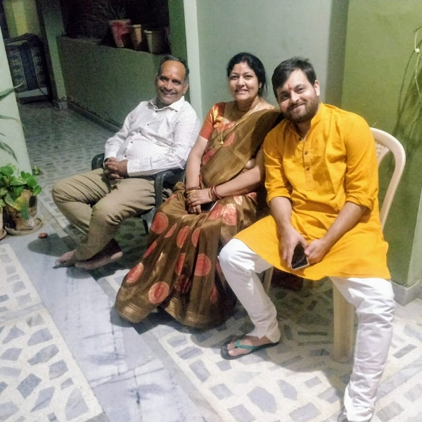Devesh Dixit with his parents
