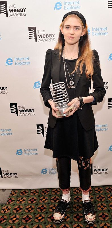Grimes with her Webby Award