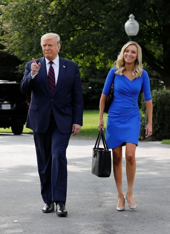 Kayleigh McEnany walking behind Donald Trump