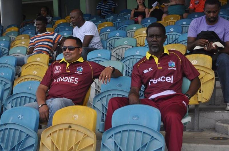 Keemo Paul's father with Safraz Sheriffudeen during a test match in Barbados