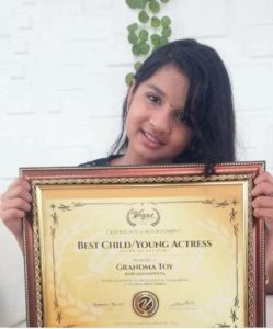 Mahaswetha with her Las Vegas Best Child Actress Award
