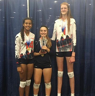 Maci Currin and her Friends Holding their Trophy from 2019 USA Volleyball GJNC