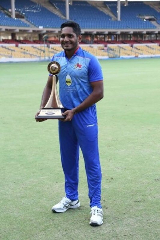 Tushar Deshpande with the Vijay Hazare Trophy after winning the final match