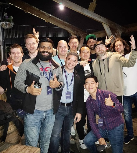 Arun Maini (green cap) with Gaurav Chaudhary (grey sweater front) and other YouTubers during a launch event