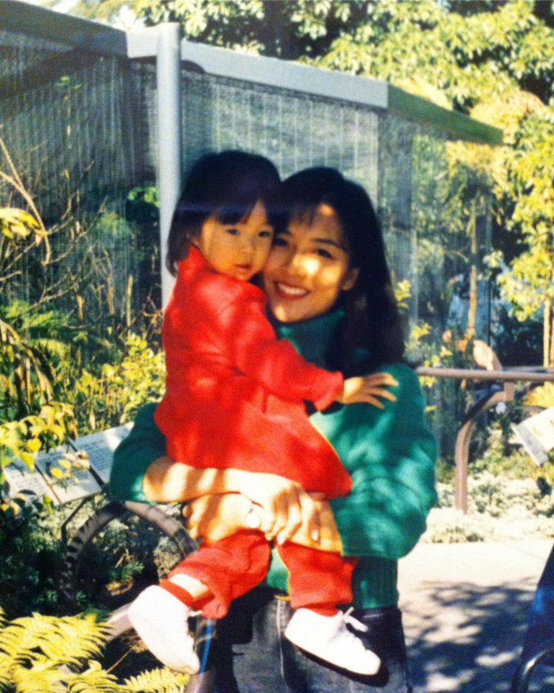 Childhood picture of Ashley Park with her mother