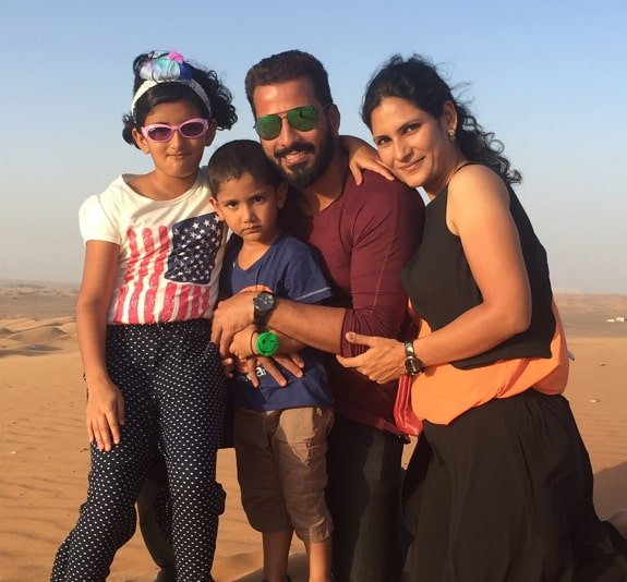 Jithan Ramesh with his wife and children