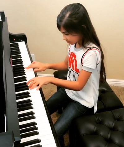 Madison Taylor Baez Playing the Piano