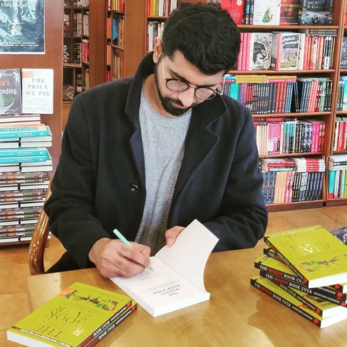 Shwetabh signing his book during its launch at a book store