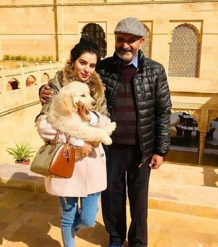 Sukirti Kandpal with her Father and her Pet Dog