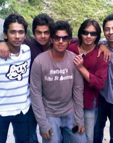 Long-haired young Tejashwi Yadav (second from right in red shirt) along with Virat Kohli (second from left) and his cricket mates