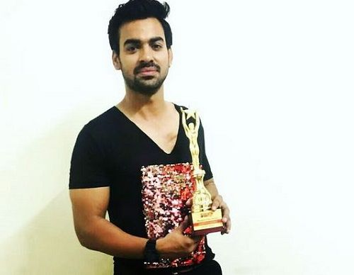 Aditya Ojha with his Award