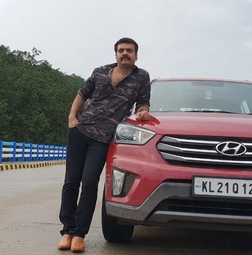 Anil Nedumangad with his Car
