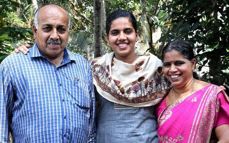 Arya Rajendran with her parents