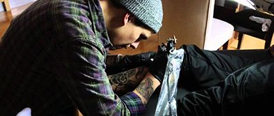Dalton Gomez's Brother Tattooing a Person