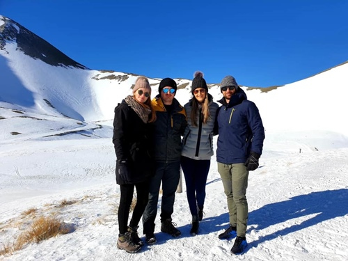 Devon Conway(right) with his fiance and friends on a trip to South Island