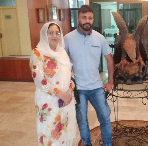Dr. Fiza Khan's mother, Salma Khan, and her brother, Khan Jee
