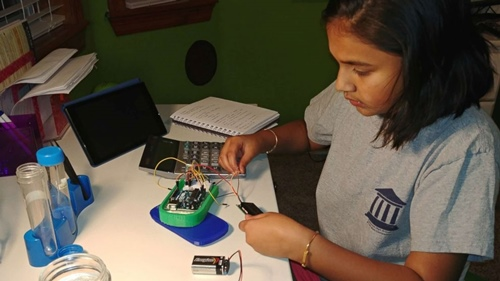 Gitanjali Rao working on the prototype of her invention, Tethys