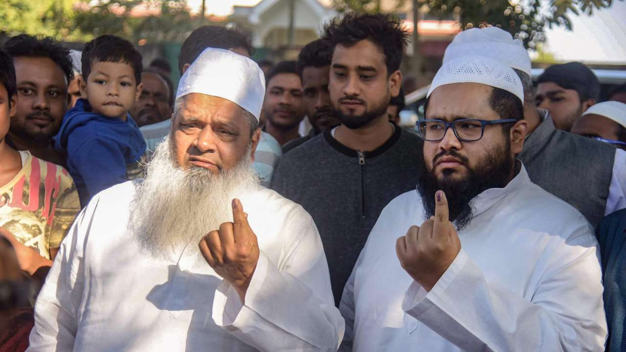 Maulana Badruddin Ajmal with his son Maulana Abdur Rahim Ajmal after casting votes in Assam panchayat election 2018