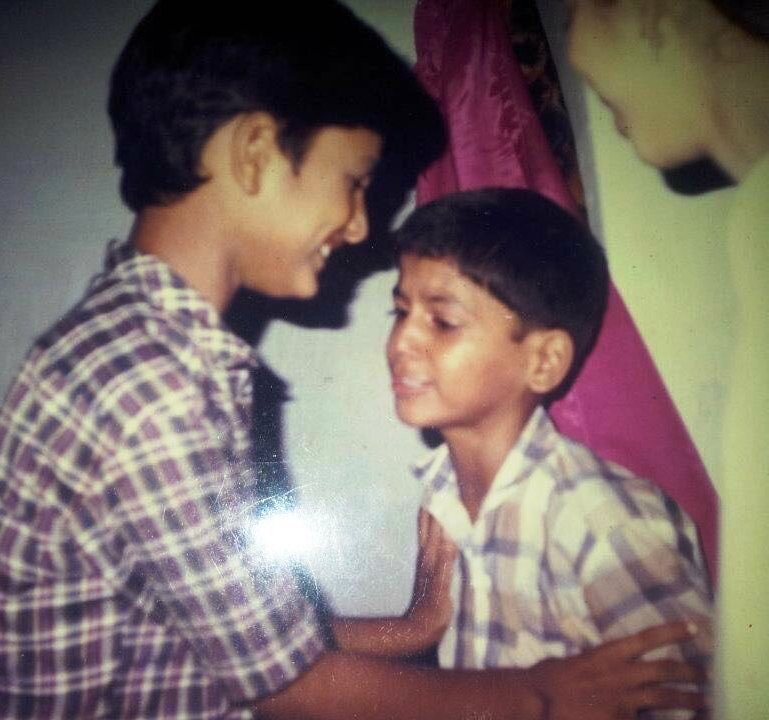 Saurabh Dwivedi cries while one of his cousins tries to bring him in front of the camera