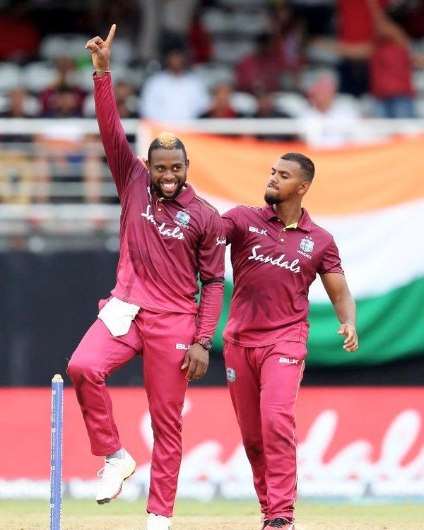 West Indian cricketer Fabian Allen raising his hand with joy after taking a wicket