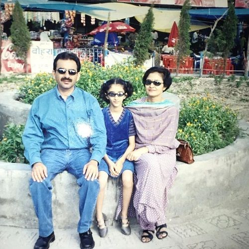 A childhood picture of Kritika Avasthi with her parents