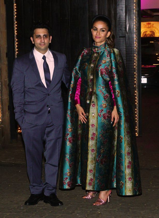 Adar Poonawalla with his wife, Natasha Poonawalla