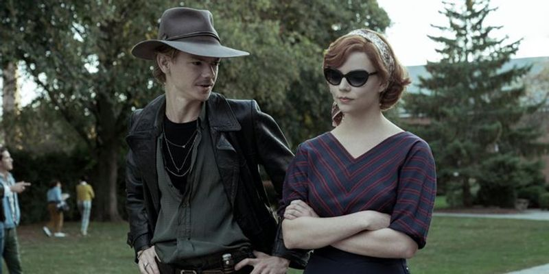 Beth Harmon (played by Anya Taylor-Joy) with Benny Watts (played by Thomas Brodie-Sangster) in a scene from The Queen's Gambit (2020)