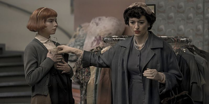 Beth Harmon (played by Isla Johnston) with Alma Wheatley (played by Marielle Heller) in a scene from The Queen's Gambit (2020)